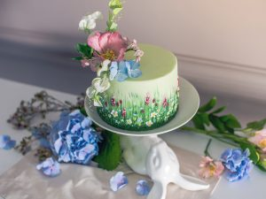Wedding spring cake decorated with beautiful flowers and hydrangeas. Desserts for a festive summer mood